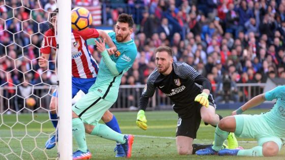 Filipe Luis, number 3 from Atletico de Madrid and Lionel Messi, number 10 from FC Barcelona and Jan Oblak, no.  13 from Atletico de Madrid during the La Liga match between Club Atletico de Madrid and FC Barcelona - La Liga at the Vicente Calderon on February 26, 2017 in Madrid, Spain.