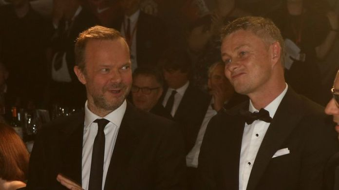 MANCHESTER, ENGLAND - NOVEMBER 25: Ed Woodward and Manager Ole Gunnar Solskjaer of Manchester United attend a match during the annual UNICEF Manchester United Dinner at Old Trafford on November 25, 2019 in Manchester, England.  (Photo by John Peters / Manchester United via Getty Images)