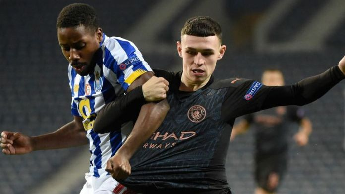 Phil Foden tangles with Wilson Manafa from Porto