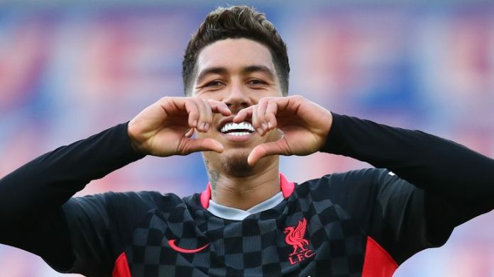 Roberto Firmino celebrates after scoring Liverpool's third goal against Crystal Palace