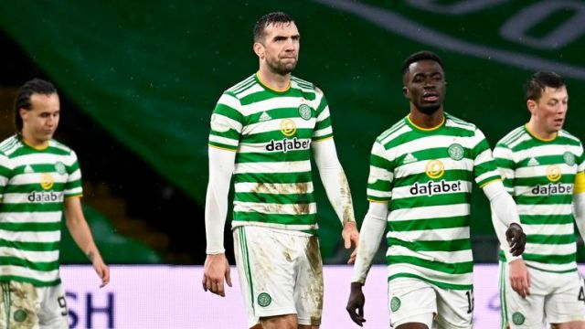 The Celtic players look dejected after conceding late on in the contest