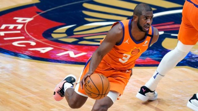 Phoenix Suns guard Chris Paul drives the ball down court against New Orleans Pelicans
