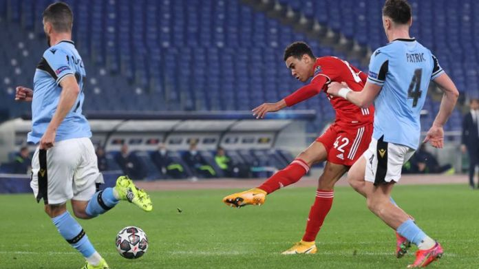 Jamal Musiala  scores for Bayern Munich against Lazio during the UEFA Champions League Round of 16 match at the Olimpico Stadium on February 23, 2021 in Rome, Italy.