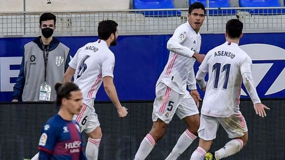 Raphael Varane is congratulated by team-mates after netting against Huesca