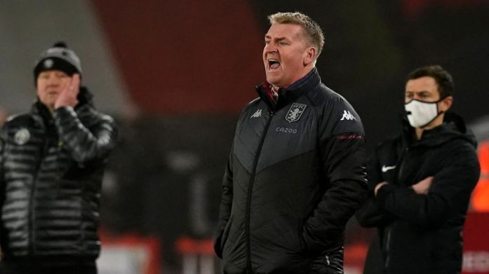 Dean Smith issues instructions from the touchline at Bramall Lane