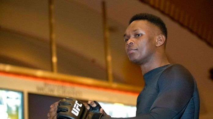 AP - UFC middleweight champion Israel Adesanya, of Nigeria, prepares for a UFC 248 open workout,