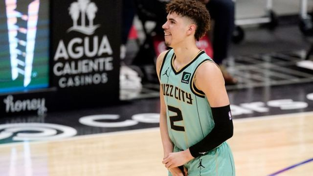 Charlotte Hornets guard LaMelo Ball holds his right wrist during (AP)