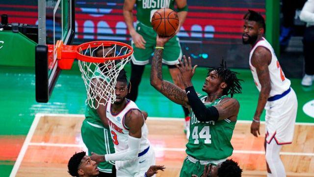 AP - Boston Celtics center Robert Williams III (44) shoots against the New York Knicks