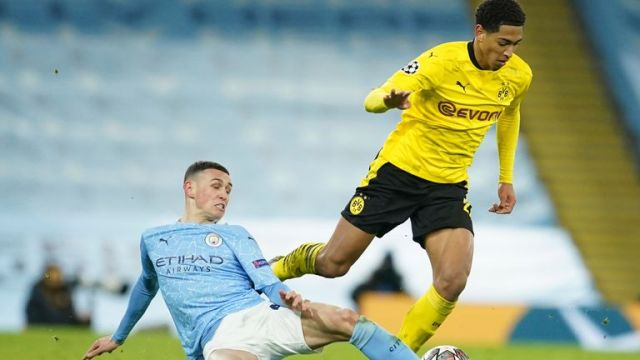 Phil Foden tries to dispossess Jude Bellingham