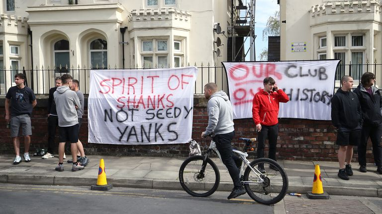 Liverpool supporters hung banners outside Anfield on Saturday