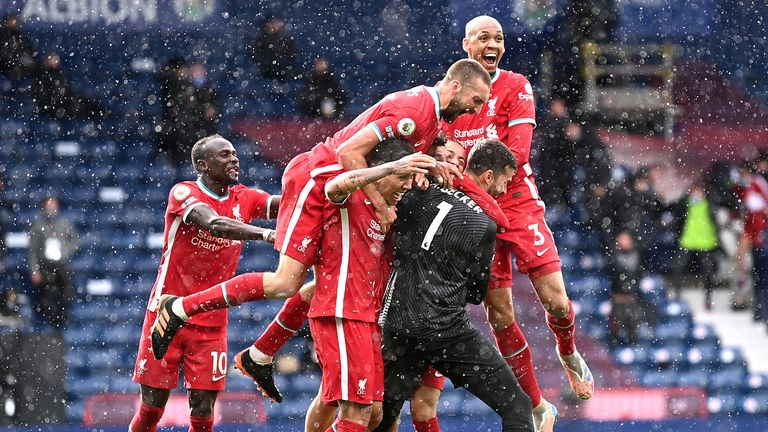 Alisson is mobbed after scoring a late winner for Liverpool at West Brom