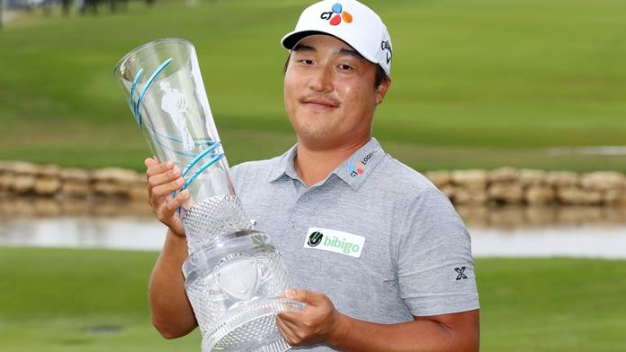 KH Lee of South Korea celebrates with the trophy after winning the AT&T Byron Nelson in McKinney, Texas