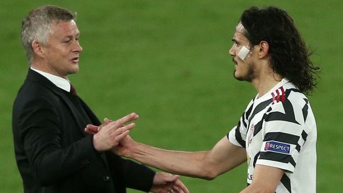 Manchester United manager Ole Gunnar Solskjaer shakes hands with Edinson Cavani following his substitution during the Roma game