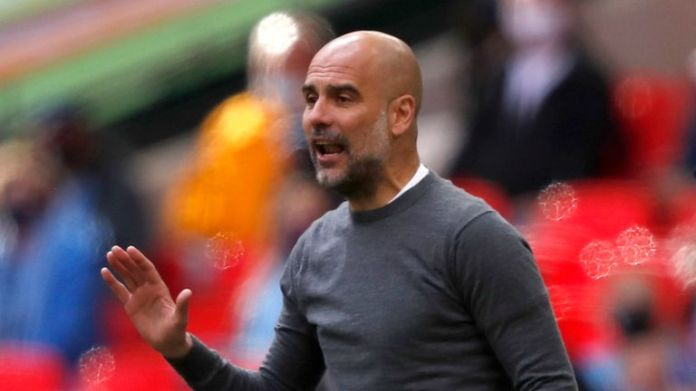 Manchester City head coach Pep Guardiola gestures during the English League Cup final soccer match between Manchester City and Tottenham Hotspur at Wembley Stadium in London on Sunday 25 April 2021.