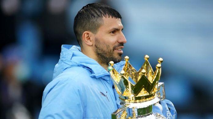 Sergio Aguero pictured holding the Premier League trophy