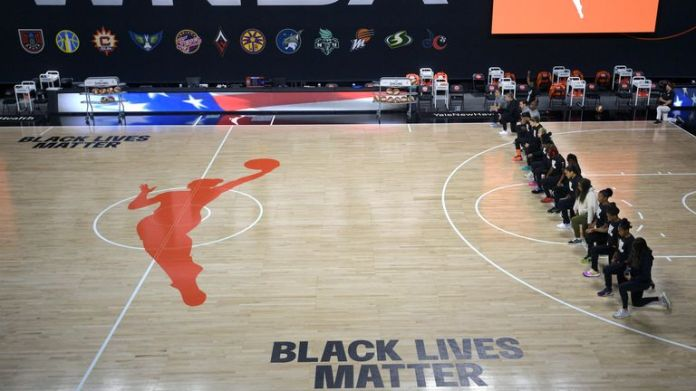 Members of the Connecticut Sun team kneel during the playing of the national anthem before a WNBA basketball game against the Washington Mystics (AP Photo/Phelan M. Ebenhack)