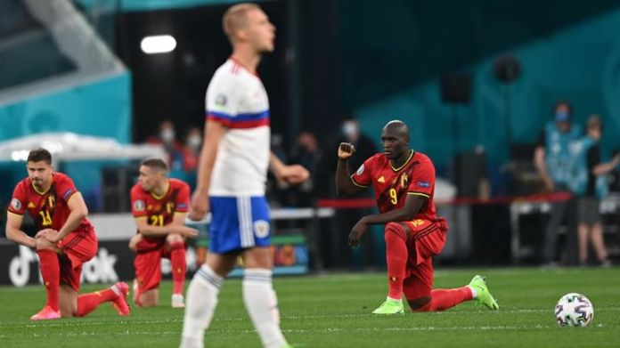 Belgium players knelt before their match against Russia in an anti-racism gesture