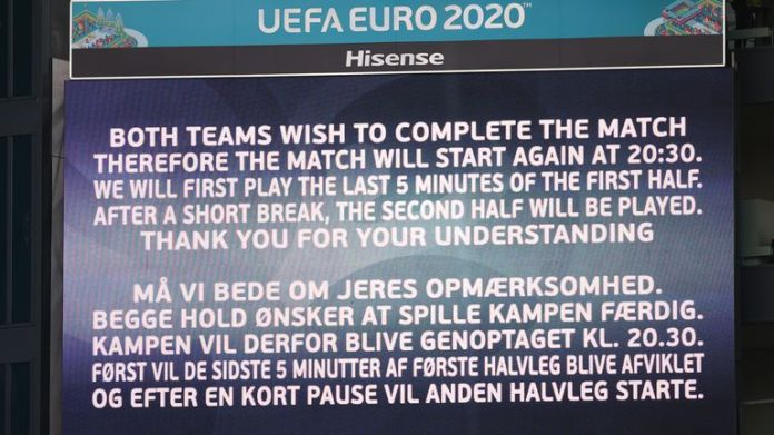 A message is displayed at Telia Parken before Denmark vs Finland restarts after Christian Eriksen collapsed on the pitch