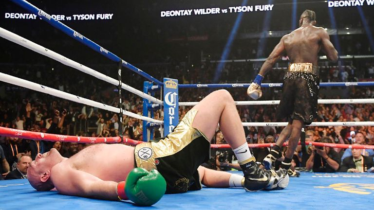 Tyson Fury, of England, lies on the canvas after being knocked down by Deontay Wilder during the 12th round of a WBC heavyweight championship boxing match Saturday, Dec. 1, 2018, in Los Angeles. (AP Photo/Mark J. Terrill)