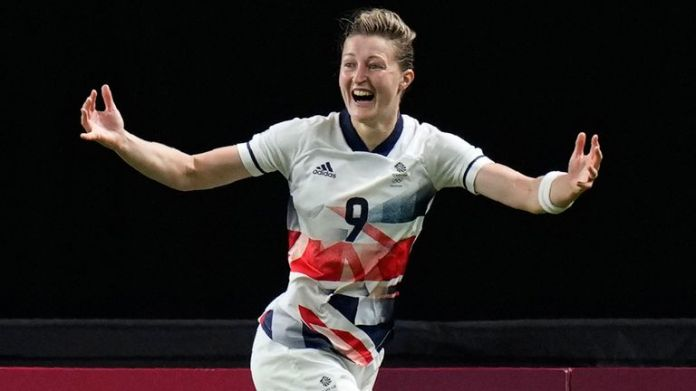 Britain's Ellen White celebrates scoring her side's opening goal during a women's soccer match against Japan at the 2020 Summer Olympics, Saturday, July 24, 2021, in Sapporo, Japan.