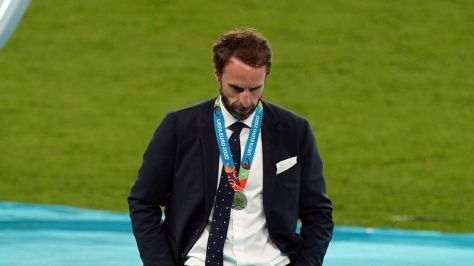 England manager Gareth Southgate and Harry Kane (left) are dejected following the UEFA Euro 2020 Final at Wembley Stadium