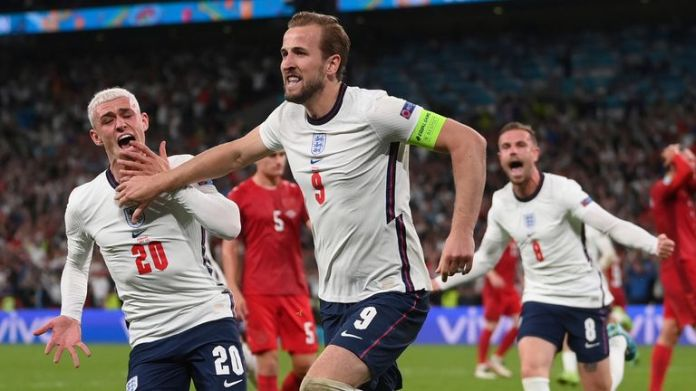 England's Harry Kane celebrates after scoring his side's second goal during the Euro 2020 soccer semifinal match between England and Denmark at Wembley