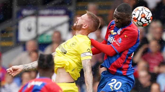 Pontus Jansson and Christian Benteke compete for a header