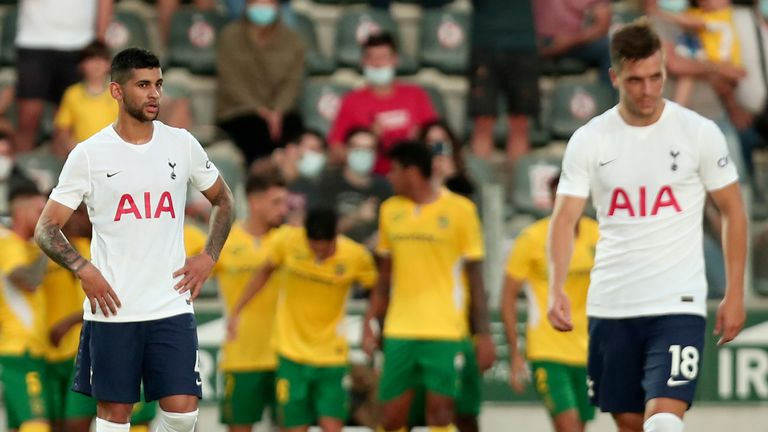 Tottenham's Cristian Romero and Giovani Lo Celso, right, react after Pacos de Ferreira score the opening goal