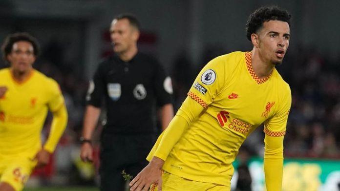 Curtis Jones celebrates after his long-range strike puts Liverpool 3-2 ahead