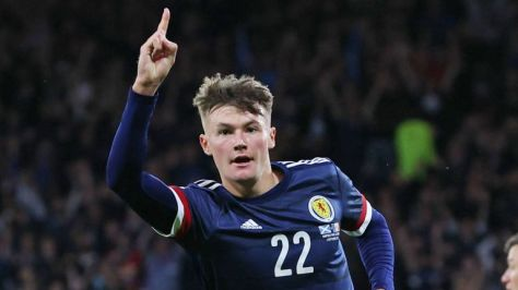 Scotland's Nathan Patterson celebrates after his shot is tapped in by Lyndon Dykes against Moldova