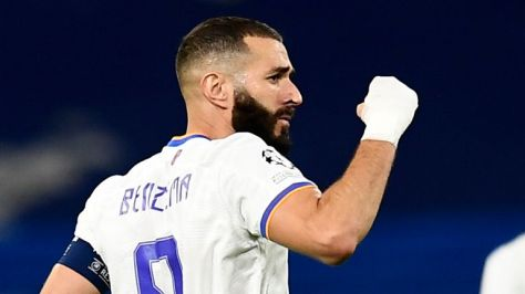 Real Madrid's Karim Benzema, left, celebrates after scoring his side's opening goal from penalty spot during the Champions League group D soccer match between Real Madrid and Sheriff,