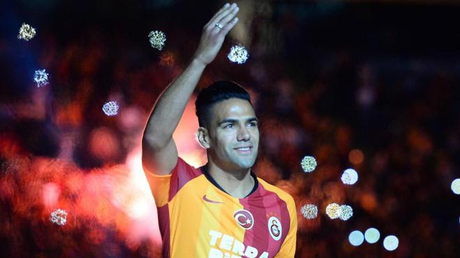 Radamel Falcao greets Galatasaray fans during their ...
