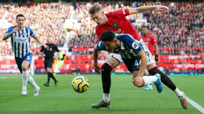 Alzate receives a foul from Scott McTominay.