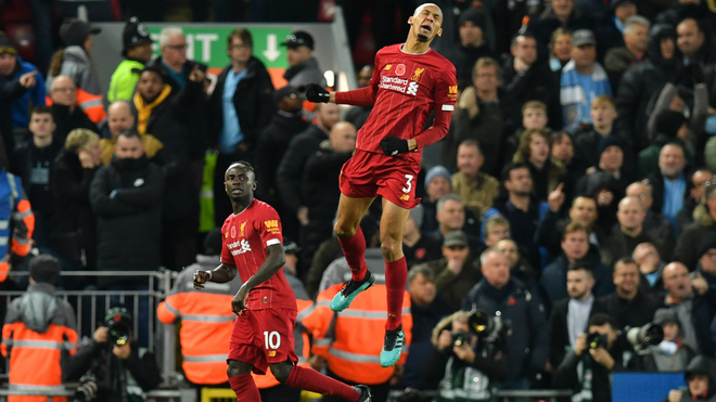 Fabinho celebrates his goal in the eyes of Sadio Man