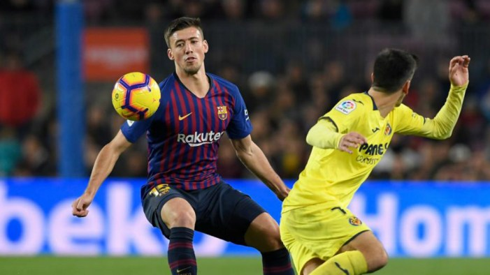Lenglet vies with Gerard Moreno during the  match FC Barcelona against...