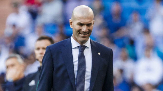 Zidane smiling during the match.
