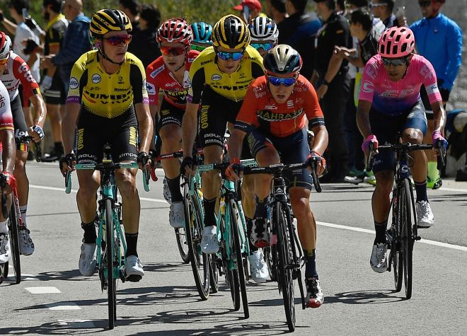 Team Jumbo rider Slovenias Primoz Roglic (2L) rides in Puerto de Navacerrada during the 18th stage of the 2019 La <HIT>Vuelta</HIT> cycling Tour of Spain, a 177,5 km race from Colmenar Viejo to Becerril de la Sierra on September 12, 2019. (Photo by OSCAR DEL POZO / AFP)
