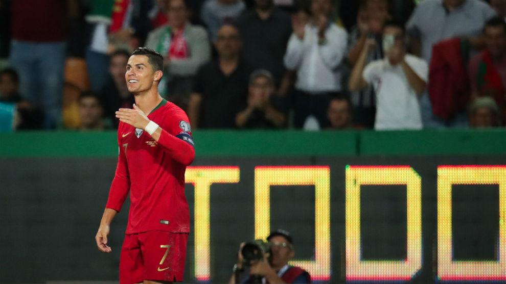 Cristiano Ronaldo celebrates scoring his 700th career goal against...