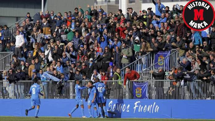 Fuenlabrada players celebrate one of Huesca's goals with ...