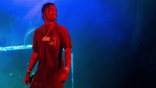 Travis Scott will perform a concert for millions on the platform of...