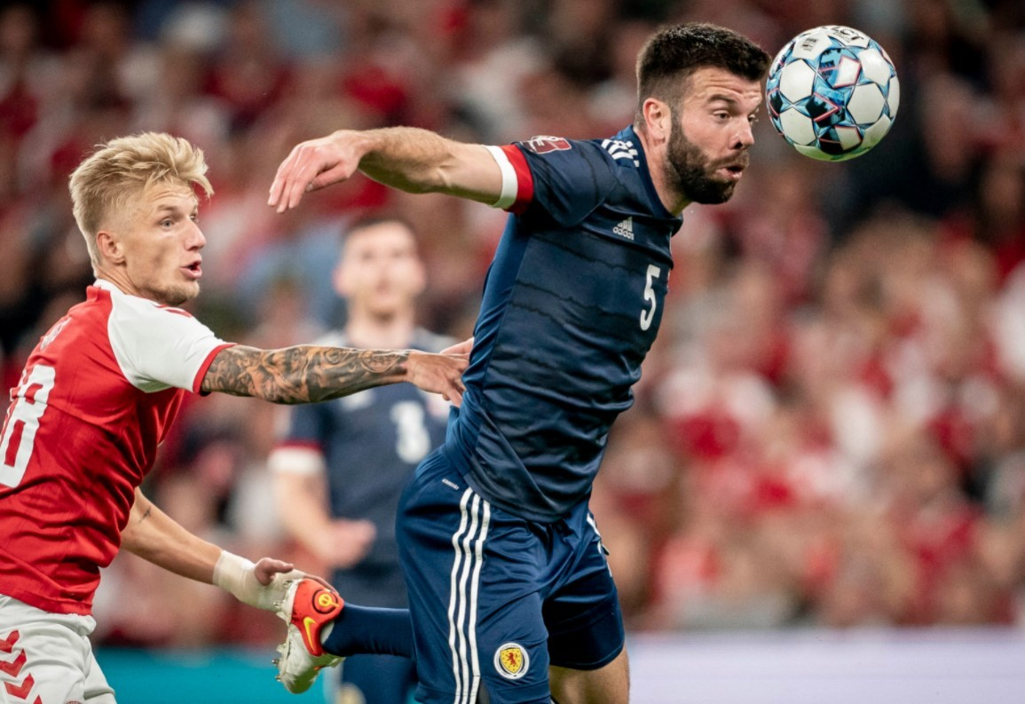 Wass puts pressure on Scottish player Grant Hanley in the World Cup qualifier.