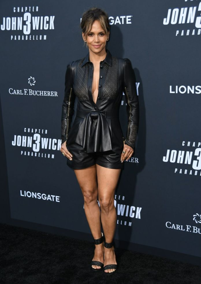 The actress Halle Berry wearing legs and neckline with a mono black...