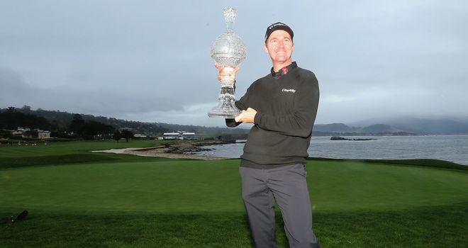 Jimmy Walker poses with the trophy after winning the AT&T Pebble Beach National Pro-Am