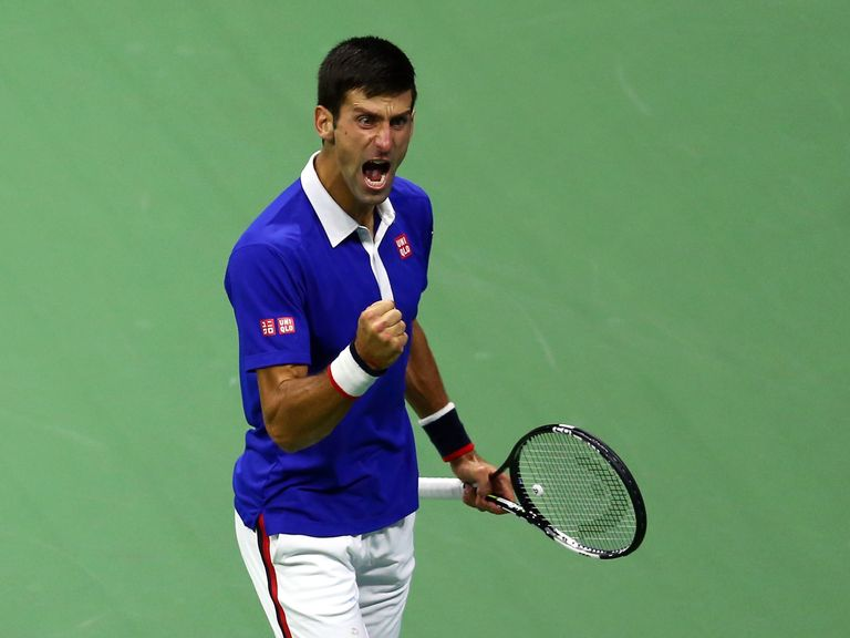 Novak Djokovic celebrates a point against Roger Federer during their Men's Singles Final