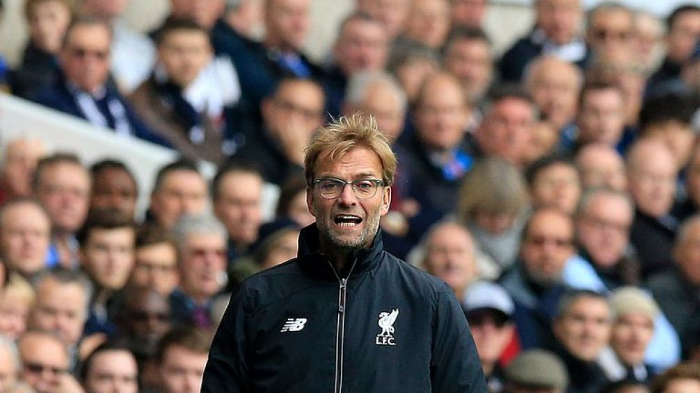 Liverpool's manager Jurgen Klopp gestures on the touchline during his first Premier League match at White