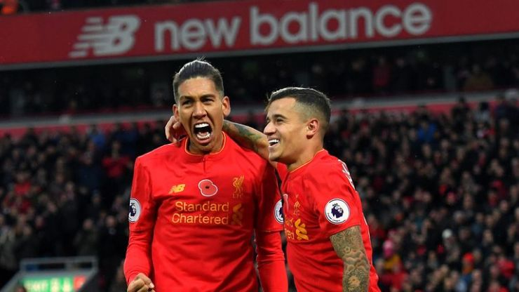 Roberto Firmino (left) and Philippe Coutinho (right) were on target against the Hornets at Anfield