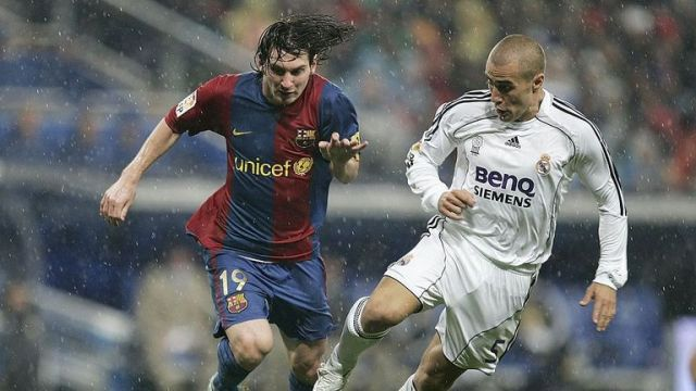 Cannavaro battling with a young Lionel Messi during El Clasico