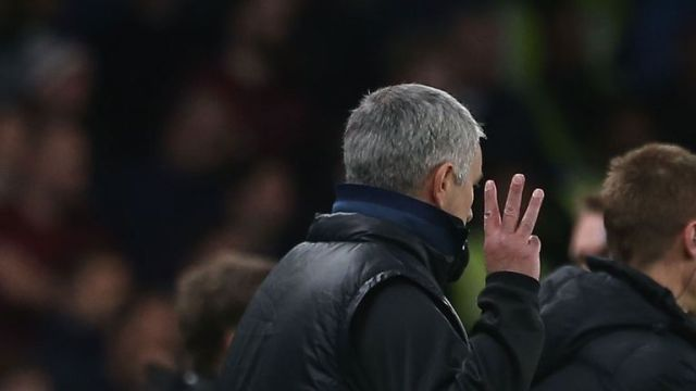Mourinho holds aloft three fingers - signalling the three Premier League titles he won at Chelsea