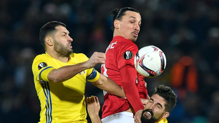 Zlatan Ibrahimovic tussles with Aleksandr Gatskan during the Europa League fixture