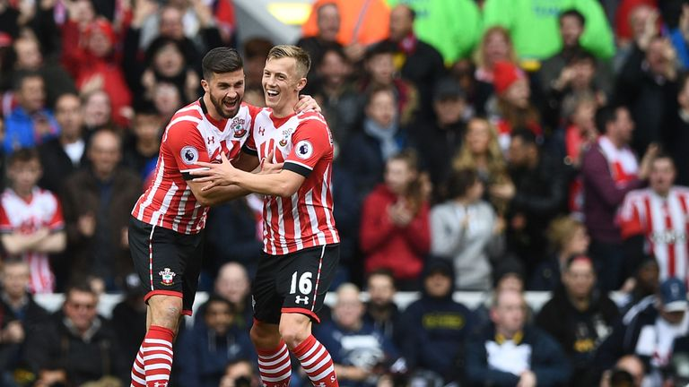 James Ward-Prowse celebrates with Shane Long after pulling a goal back for Southampton at White Hart Lane
